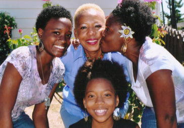 Claudette Hubbard with her U.S. citizen daughter and granddaughters